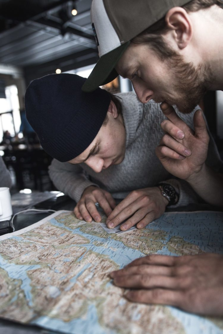 planning the sailingtrip and looking at the map for safe lines in the mountain to ski